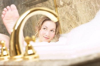 Woman relaxing in bubble bath uid 1
